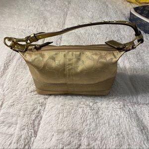Gold coach mini purse